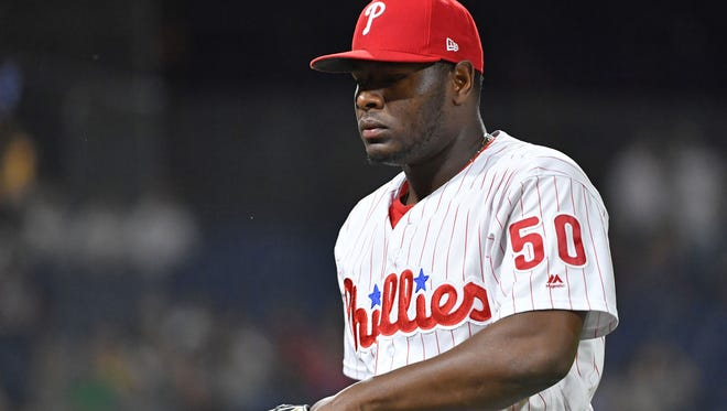 Philadelphia Phillies relief pitcher Hector Neris (50) walks off the field after allowing two home runs in the ninth inning against the New York Mets at Citizens Bank Park. Mandatory Credit: Eric Hartline-USA TODAY Sports