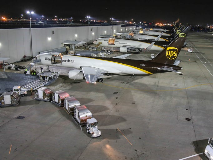 Airplanes line up on the tarmac at UPS' Worldport.