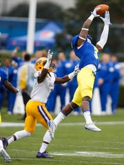 Delaware defensive back K.C. Hinton breaks up a pass intended for Albany's Jordan Crockett-and nearly intercepts it -in the first quarter at Delaware Stadium.