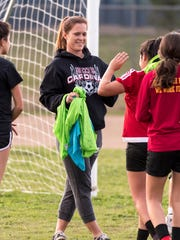 Orosi head coach Sara Carter, center, works with her team during practice Monday, February 12, 2018.