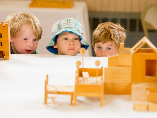 From left, Augustus Mullins, ZaoHan Ferrari, Graham Kircher, Jaxon Dennis, all students at the Trumansburg Montessori School, look at building miniatures by longtime Trumansburg resident Julie Hardin. Her work is on display at the Trumansburg Conservatory of Fine Arts through June 7.
