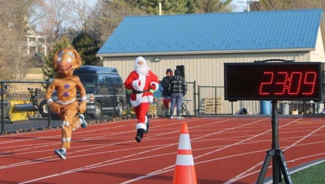 Waynesboro's Nathan Wynkoop, 13, wearing the Gingerbread Man suit, topped all competitors (even Santa Claus) at the Caring 4 Kids Jingle Bell 5K in Waynesboro last weekend.