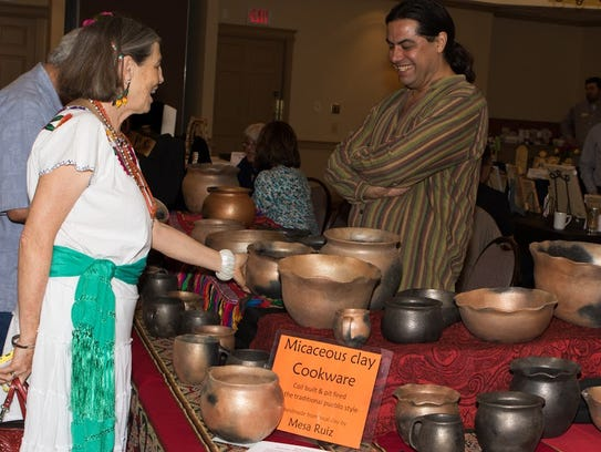 A curious onlooker asks abou the micaceous clay cookware