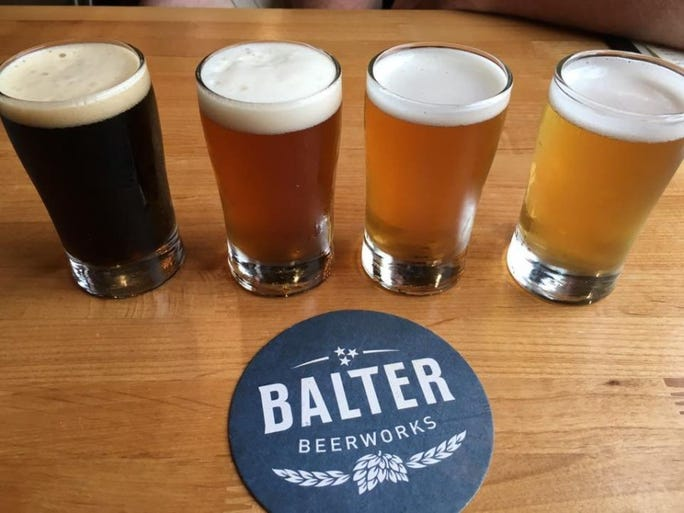 Balter Beerworks, located at 100 S. Broadway in Knoxville, features several beers brewed on site and a full menu. From left, Bear Blend Coffee Oatmeal Porter, Firebelly IPA, Maypop APA and Good Neighbor.