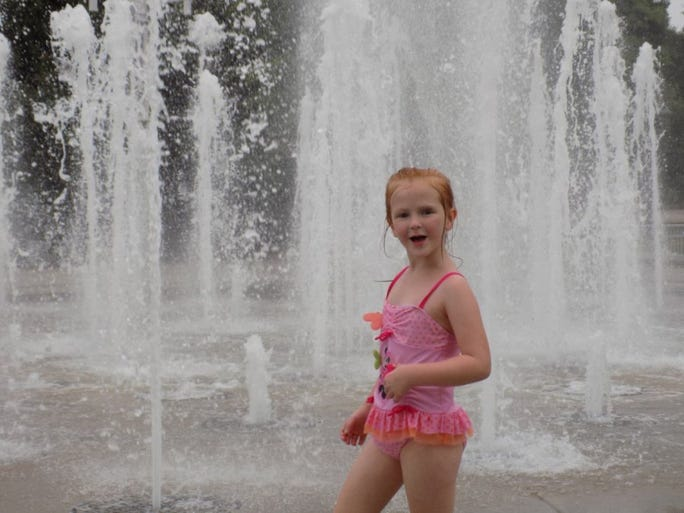 Contributed photo Abigail Standifer, 5, of Knoxville plays in the water at World's Fair Park.