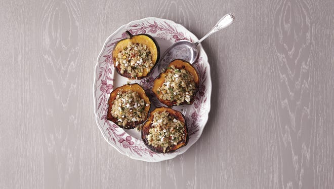 For a seasonal and satisfying vegetarian Thanksgiving dish, try acorn squash stuffed with grains, nuts and cheese.