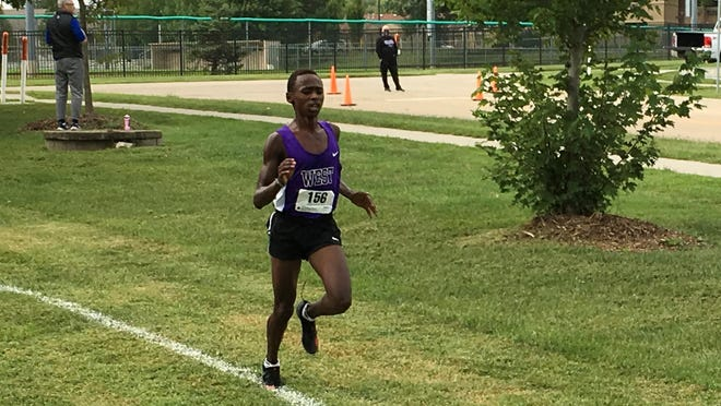 Topeka West sophomore Lenny Njoroge closes out his win in Saturday's Topeka West Joe Schrag Invitational at the Kanza Park course. Njoroge posted his second career victory in a 5-kilometer time of 16:46.88.