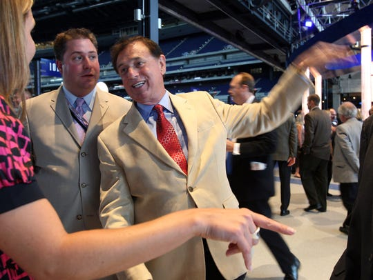 Forrest Lucas spoke with Jeff Vetting (left) and Suzanne Ludera of Live Nation in 2008 during the Grand opening of Lucas Oil Stadium.