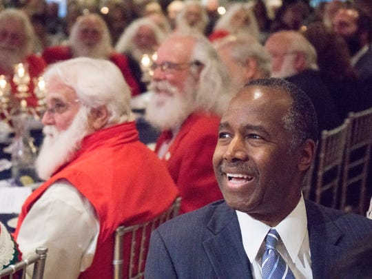 Dr. Ben Carson reacts to a joke by the Rev. Joseph Marquis.