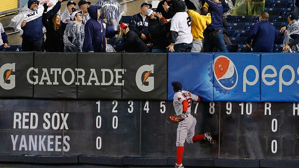 Rusney Castillo of the Boston Red Sox cannot reach a home run hit by Carlos Beltran of the New York Yankees in the second inning during their game at Yankee Stadium on October 1, 2015 in New York City.