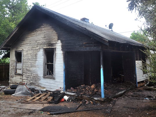 Ave Q Burned House