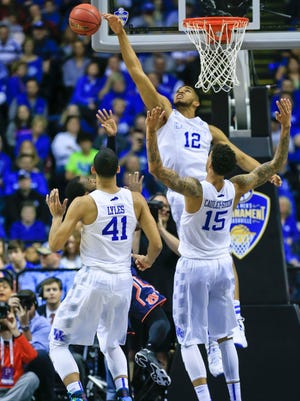 Kentucky's Karl-Anthony Towns blocks a shot in the second half of the SEC semifinal game in Nashville. The Wildcats had seven blocks as a team, with 39 rebounds to Auburn's 25.  By Matt Stone, The Courier-Journal March 14, 2015