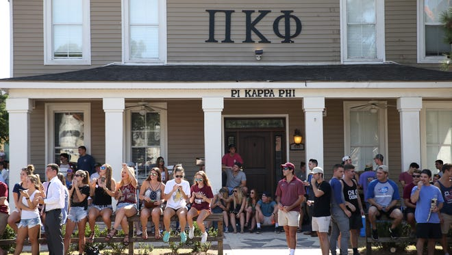 A crowd of supporters in front of the Pi Kappa Phi fraternity house during last year's parade. The fraternity has been shut down following the Nov. 3, 2017 death of pledge Andrew Coffey.