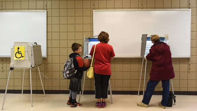 Cael Nofziger waits for his mom, Melissa, as she votes along with Lisa Tunge during the city election at Kuehn Community Center in Sioux Falls, S.D., Tuesday, April 12, 2016.