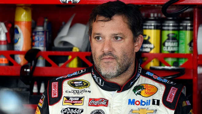 NASCAR driver Tony Stewart looks out from his garage on Sept. 13 during a practice for the Sprint Cup Series race at Chicagoland Speedway in Joliet, Ill.
