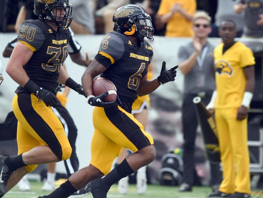 Southern Miss defensive back  Kelsey Douglas runs the
