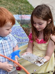 Leo Allison and Julia Cox learn about ladybugs before