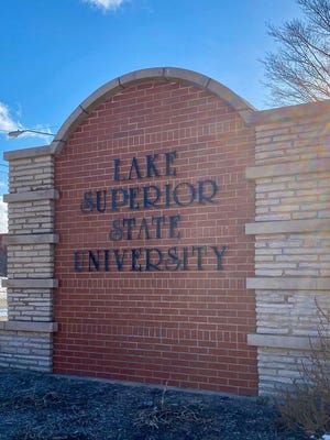 A brick sign of Lake Superior State University, located toward the main entrance of the university.