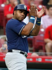 Brewers first baseman Jesus Aguilar reacts after scoring against the Reds earlier this season.