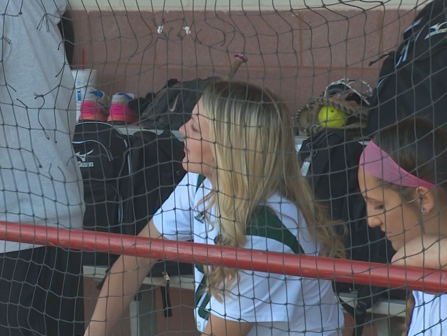 Hallie Crossnoe cheers her teammates on from the dugout