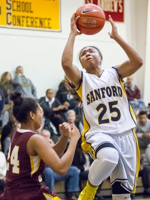 Sanford's Chrishyanah Alston puts up a shot during a game at Sanford High School on Monday evening. Sanford defeated St. Elizabeth's by a score of 53-43.