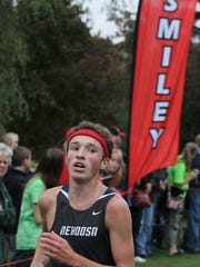 Nekoosa's Benji Eidenschink checks the clock as he finishes first in the D2/3 boys varsity race at last year's Smiley Invitational. The meet is in its 59th year and will be held Saturday.