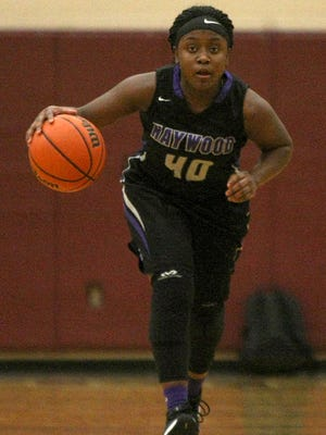 Haywood's Wandarkyu Young pushes the ball up the floor against Liberty in the District 15-AA championship game.