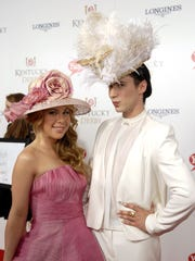 Olympians Tara Lipinski and Johnny Weir pose for a