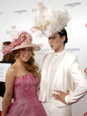 Olympians Tara Lipinski and Johnny Weir pose for a photo on the Derby Red Carpet.  May 03, 2014