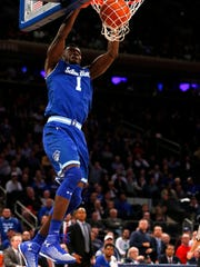 Mar 9, 2017; New York, NY, USA; Seton Hall Pirates forward Michael Nzei (1) dunks against Marquette Golden Eagles during second half of Big East Conference Tournament Quarterfinals at Madison Square Garden. Seton Hall Pirates defeated Marquette Golden Eagles82-76.Mandatory Credit: Noah K. Murray-USA TODAY Sports
