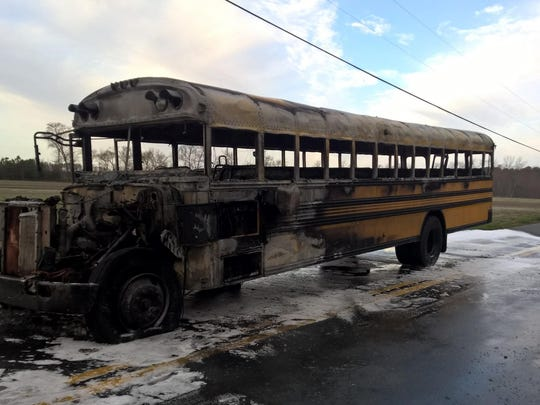 The driver and two children safely got off a school bus that caught fire on the side of the road Monday morning near Millsboro, state police said.