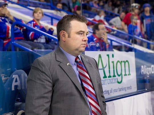 Cam Ellsworth stands behind the bench during his time as a men's hockey assistant coach for UMass-Lowell. Ellsworth will be the next head coach for Norwich University.