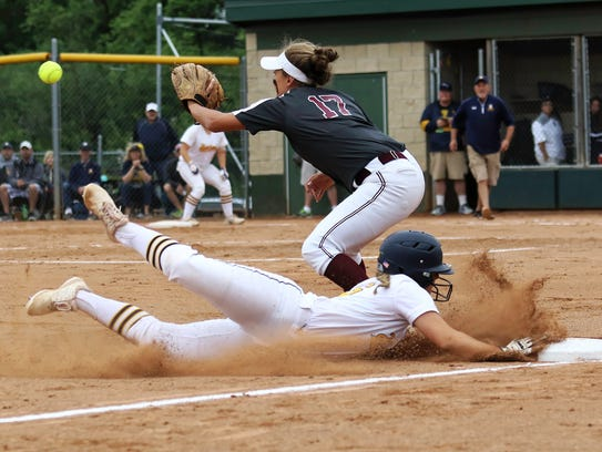 Hartland's Delaney Robeson slides into third base during