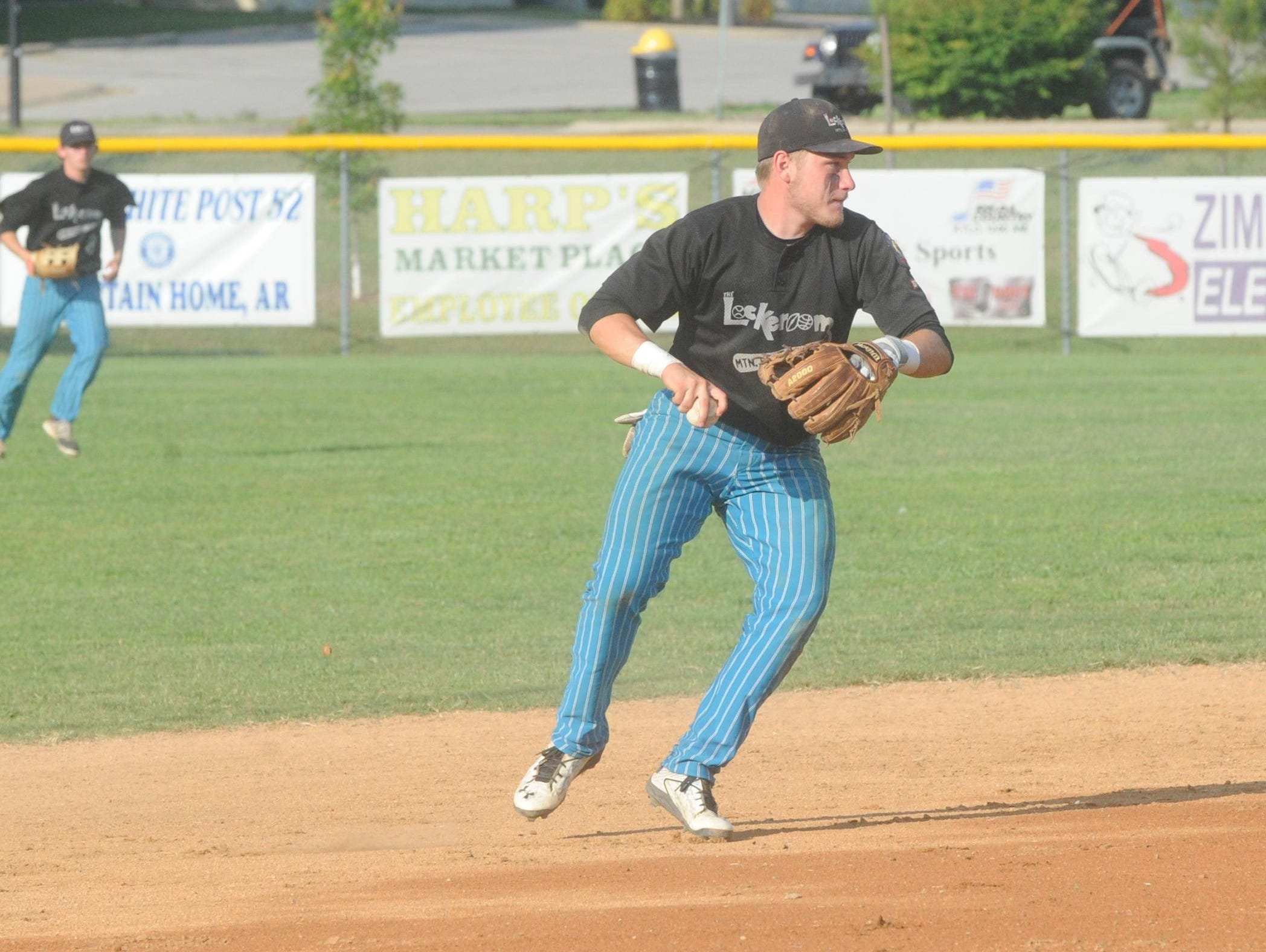 Lockeroom shortstop Hayden Hall fields a grounder and prepares to throw to first base during a game earlier this season at Cooper Park. Hall will play college baseball at Northeastern Oklahoma A&M College in Miami, Okla.