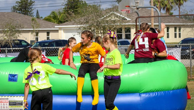 The Cape Coral Fastpitch Little League Softball program, bursting with hundreds of girls ranging from 4 to 16, celebrated opening day with a variety of games and fun activities last Saturday at Burton Memorial Park in Cape Coral.