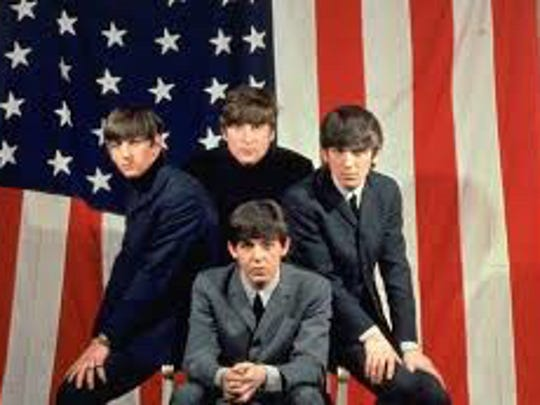The Fab Four pose in front of the Stars and Stripes in 1964  to promote their first U.S. tour, which Ventura journalist Ivor Davis covered.