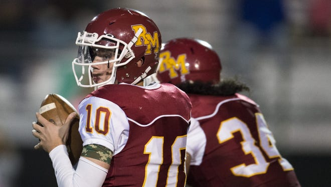Rocky Mountain High School quarterback Tyler Hyland, shown in a file photo, scored the Lobos only touchdown in a loss to Columbine last week. Rocky Mountain hosts Fossil Ridge at 6 p.m. Thursday.