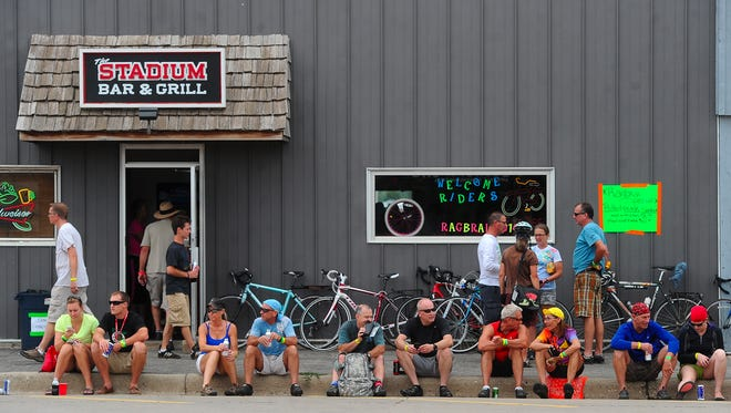 Riders take a break in Rock Valley on Saturday during the RAGBRAI ride.