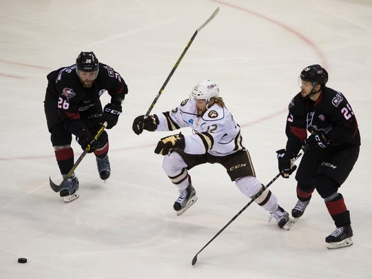Hershey left wing Nathan Walker (12) splits Lake Erie's Jaime Sifers (26) and Alex Broadhurst (25) during the Bears' 4-1 loss to Lake Erie in Game 1 of the Calder Cup Finals on Wednesday at Giant Center.
