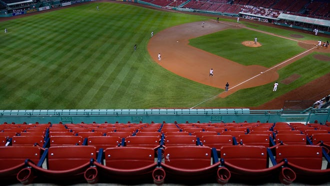 Empty seats sit in a stadium without fans during the fourth inning of a Boston Red Sox baseball game at Fenway Park in Boston, Thursday, Sept. 24, 2020. The Red Sox played their final home game of the COVID-19 outbreak-disrupted season, against the Baltimore Orioles.