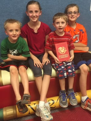 Left to Right: Jaxon, Laci, Tristan and Porter Pannell. Tristan won replicas of Harry Potter's textbooks from a scavenger hunt on June 1.