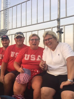 Katelyn Falgowski's brother Tim, dad Ken and mom Cindy join Caitlin Van Sickle's mom Lori in the stands at the U.S.-Argentina Olympic field hockey opener Saturday in Brazil.