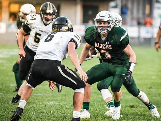 Vincennes Lincoln's Spencer Corrona looks to provide a block in a game against Boonville last season.