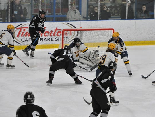 Firing the puck past Trenton goalie Dominik DeMaggio