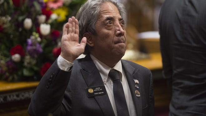 Sen. John Kefalas is sworn in for another term as the Colorado Senate convenes in its first session of the 71st General Assembly in Denver on Jan. 11.