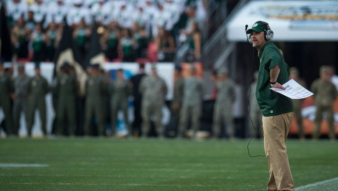 CSU coach Mike Bobo looks to the scoreboard as the Buffaloes put up the first touchdown during the Rocky Mountain Showdown at Sports Authority Field at Mile High in Denver on Friday, September 1, 2017.
