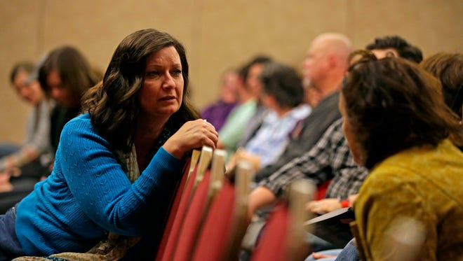 Kim Robinson, left, and Kim Ritzow of Appleton take part in a role playing exercise as part of suicide prevention training during the Kids in Crisis program Tuesday, April 11 at the Radisson Paper Valley Hotel in Appleton.