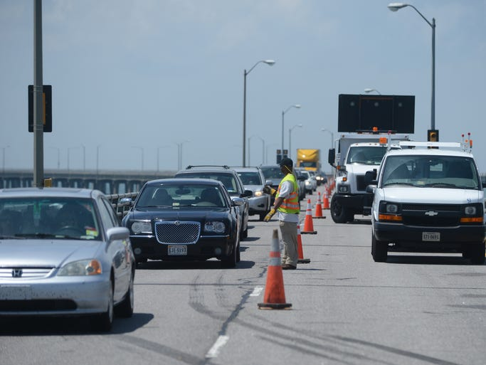 Northbound traffic begins to flow as one lane is opened on the Chesapeake Bay Bridge-Tunnel after a tractor trailer crashed over the side of the bridge on Thursday, May 15, 2014. The truck driver died in the crash. Navy divers are working to recover his body.