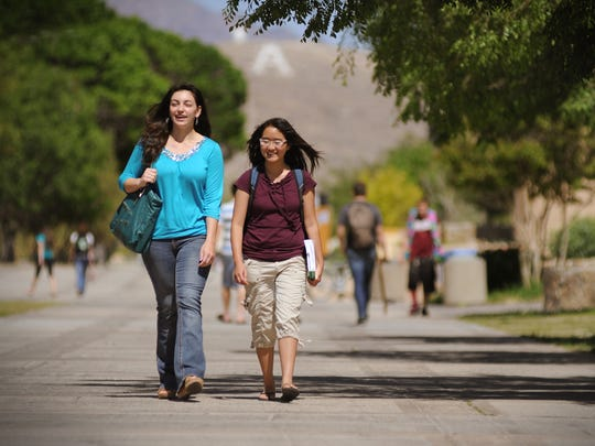 NMSU students walk up and down the International Mall.