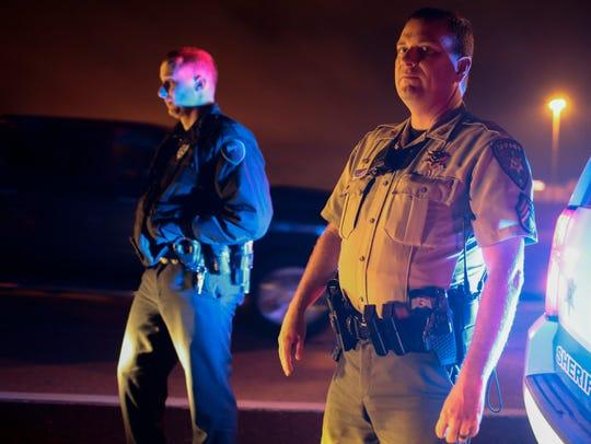 Lafayette Parish Sheriff's Sgt. Clay Carter, right,